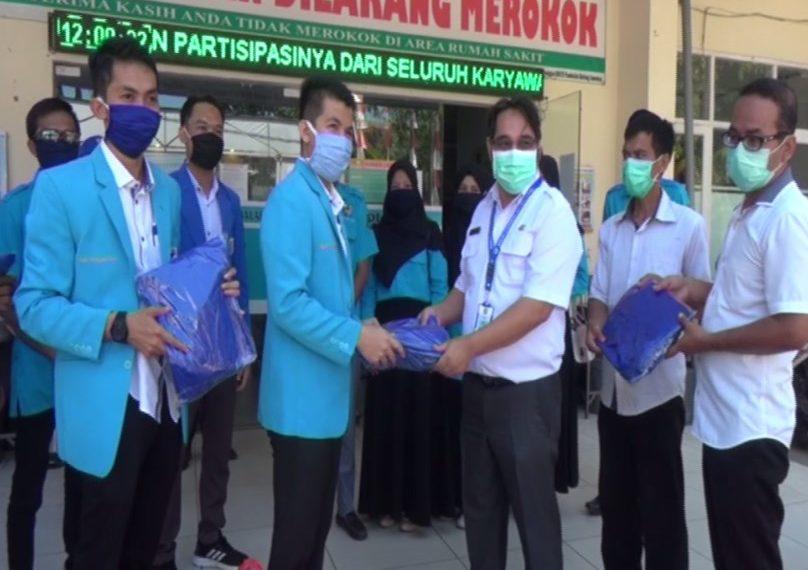 DPD KNPI HSU Serahkan Bantuan APD