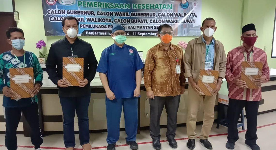 4 paslon menerima surat keterangan telah selesai menjalani proses pemeriksaan kesehatan